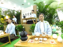 Chinese women performing tea art Stock Photography