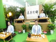 Chinese women performing tea art Stock Photos