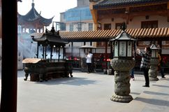 Chinese women pray at temple courtyard Shanghai China Royalty Free Stock Photos