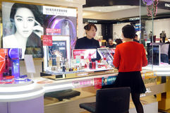 Chinese women in the purchase of cosmetics Royalty Free Stock Photography