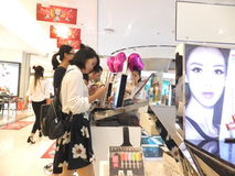 Chinese women in the purchase of cosmetics Royalty Free Stock Image