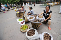 Chinese Women selling walnuts Royalty Free Stock Photos