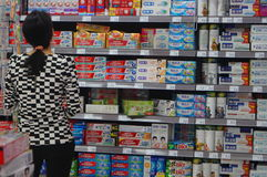Chinese women in shopping malls to buy toothpaste Stock Images