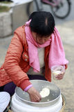 Chinese women trader sell doufunao ( jellied bean curd ) Stock Photos