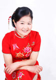 Chinese women wearing red cheongsam. Chinese woman wearing a hand-embroidered clothing Royalty Free Stock Photo