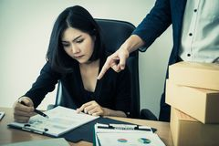 Chinese woman working with angry boss blaming. Chinese women is working with angry boss blaming Stock Photos