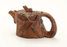 Chinese wood carving #1. Wooden teapot from Chinese wood carving shop Stock Photo