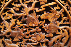 Chinese wood carving. Goldfish and lotus flower, Traditional chinese style wood carving stock photos