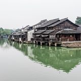 Chinese wood houses besides the river Stock Photos