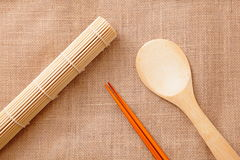 Chinese wood tableware. On linen tablecloth texture Stock Image