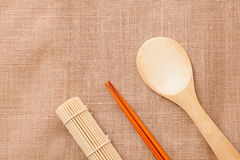 Chinese wood tableware. On linen tablecloth texture Stock Photography