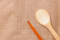 Chinese wood tableware on linen tablecloth. Texture Stock Photo