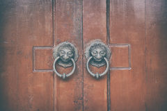 Chinese wooden door with lion head knocker architecture Stock Photos