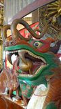 Chinese Wooden dragon with ball in mouth Stock Images