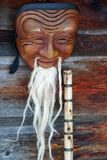 Chinese wooden mask. On the old wood background Stock Photos