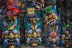 Chinese Wooden Masks Souvenirs in the market near the site of the Great Wall of China Mutianyu royalty free stock photography