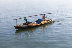Chinese wooden recreation boat with boatman Royalty Free Stock Images
