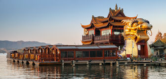 Chinese wooden recreation boats and Dragon ship Royalty Free Stock Photo