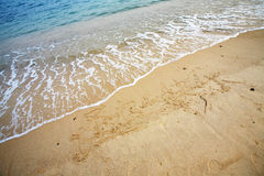 Chinese word 'merry xmas' write on beach Stock Photography