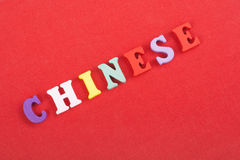 CHINESE word on red background composed from colorful abc alphabet block wooden letters, copy space for ad text Royalty Free Stock Photography