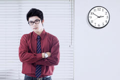Chinese worker with clock on the wall Royalty Free Stock Photo