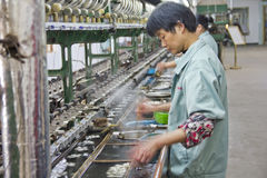 Chinese worker detaching silk cocoons Royalty Free Stock Images