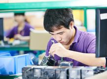 Chinese worker at manufacturing Royalty Free Stock Images
