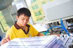 Chinese worker on plastic card production factory Royalty Free Stock Photos