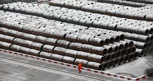 A Chinese worker walked piled rod freight yard stock images