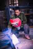 Chinese worker welding metal Stock Photo