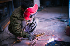 Chinese worker welding metal Stock Photos
