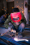 Chinese worker welding metal Royalty Free Stock Image