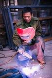Chinese worker welding metal Stock Photos