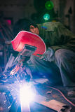Chinese worker welding metal Royalty Free Stock Photography