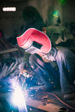 Chinese worker welding metal Royalty Free Stock Photo