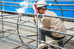 Chinese worker welding steel Royalty Free Stock Images