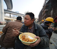 Chinese workers have lunch Royalty Free Stock Photos
