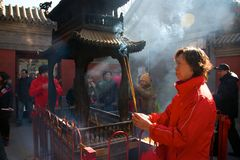 Chinese worshippers burned incense and made wishes in White Cloud Temple during Chinese New Year, Beijing, China. The White Cloud Temple or the Monastery of the royalty free stock image