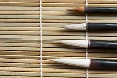 Chinese writing brush. On bamboo background royalty free stock photos