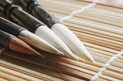 Chinese writing brush. On bamboo background royalty free stock images
