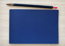 Chinese writing brush with blue notebook Royalty Free Stock Images