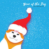 2018 Chinese year of the Dog. Happy Chinese New Year Greeting Card. Paper cut Akita Inu doggy with santa claus red hat. Snow Celebration. Place for text royalty free illustration