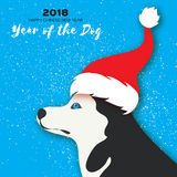 2018 Chinese year of the Dog. Happy Chinese New Year Greeting Card. Paper cut pretty Siberian Husky doggy with santa. Claus red hat. Snow Celebration. Place for Stock Photo