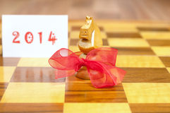The Chinese year of the horse. Chinese New Year concept, horse on a chessboard together with 2014,  the Chinese year of the horse Royalty Free Stock Image