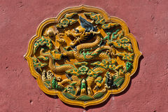 Chinese Yellow Dragon Catching Pearl Plaque in Transparent Glazed Fired Ceramic Tile Royalty Free Stock Photography