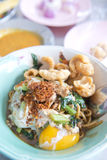 Chinese yellow noodle with egg and pork Stock Photo