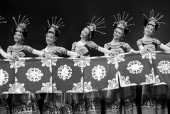 Chinese Yi ethnic dancers. CHENGDU - DEC 13: chinese Yi ethnic dancers perform folk group dance on stage at JINCHENG theater in the 7th national dance Stock Photo