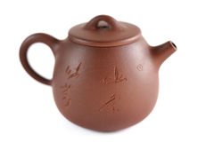 Chinese Yixing clay tea pot with insription: Zhou Ting Shou Zhi. Isolated Stock Images