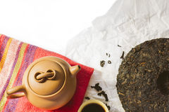 Chinese Yixing clay tea set with teapot and cup with hot black s. Chinese Yixing small clay tea set with teapot and cup with hot black shu puer tea. Tasting new Royalty Free Stock Photos