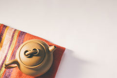 Chinese Yixing clay teapot. Colorful red fabric napkin / cloth u Royalty Free Stock Photo
